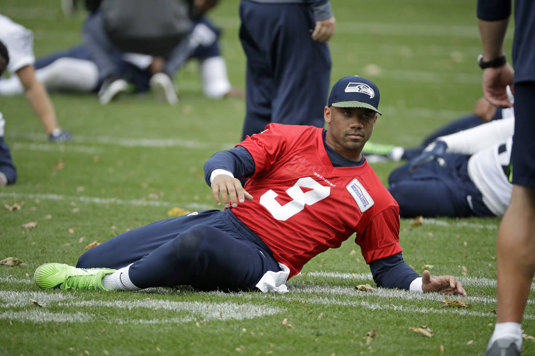 Seattle Seahawks' quarterback Russell Wilson takes part in an NFL training session at the Grove Hotel in Chandler's Cross, Watford, England, Friday, Oct. 12, 2018. The Seattle Seahawks are prepari ...