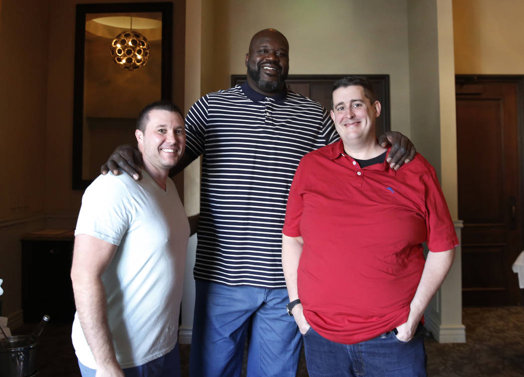 "Former NBA player and owner of ""Big Chicken"" restaurant Shaquille O'Neil, center, poses for photo with his chefs and partners Matt Piekarski, left, and Matt Silverman on Thursday, Oct. 1 ..."