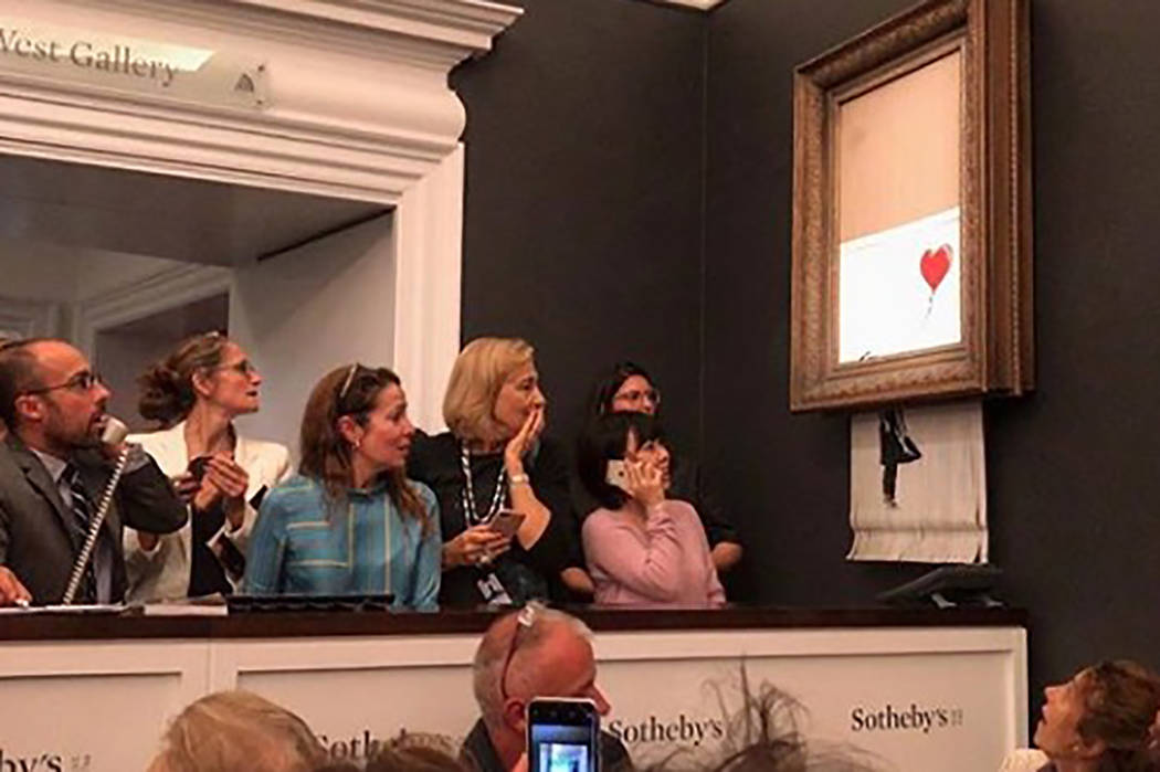 A Banksy art-work self-destructs after being sold at auction. (banksy/Instagram)