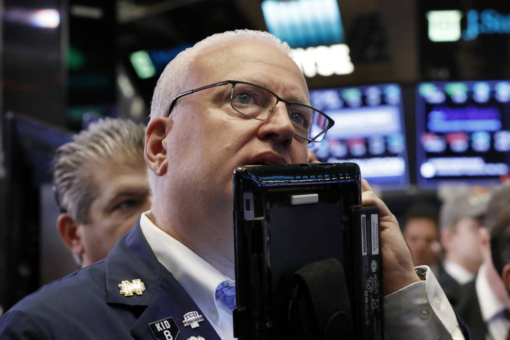 Trader Thomas Ferrigno works on the floor of the New York Stock Exchange, Thursday, Oct. 11, 2018. U.S. stocks are mostly lower in unsteady trading one day after their biggest drop since February. ...