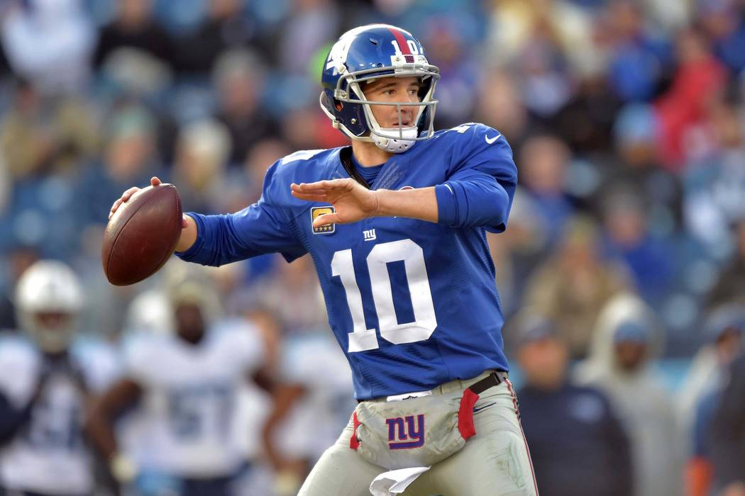 New York Giants quarterback Eli Manning (10) passes against the Tennessee Titans during the second half at LP Field on Dec. 7 in Nashville. The Giants beat the Titans 36-7. (Don McPeak-USA TODAY S ...