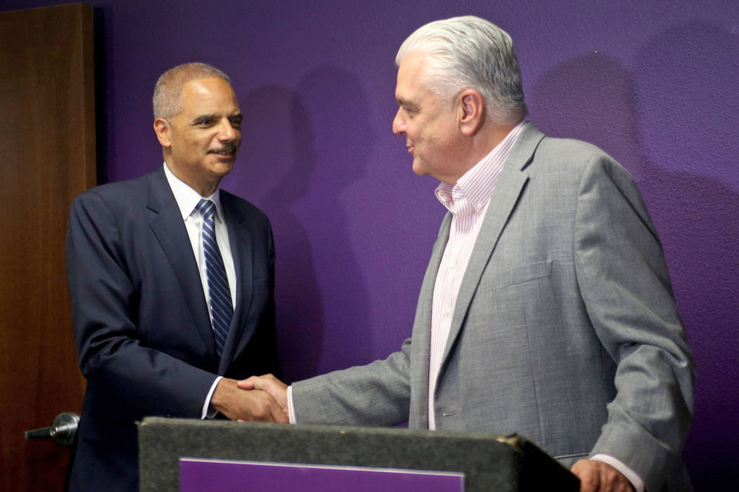 Commissioner Steve Sisolak shakes hands with former Attorney General Eric Holder, left, after he formally endorsed him for governor at the Service Employees International Union Local 1107 offices ...