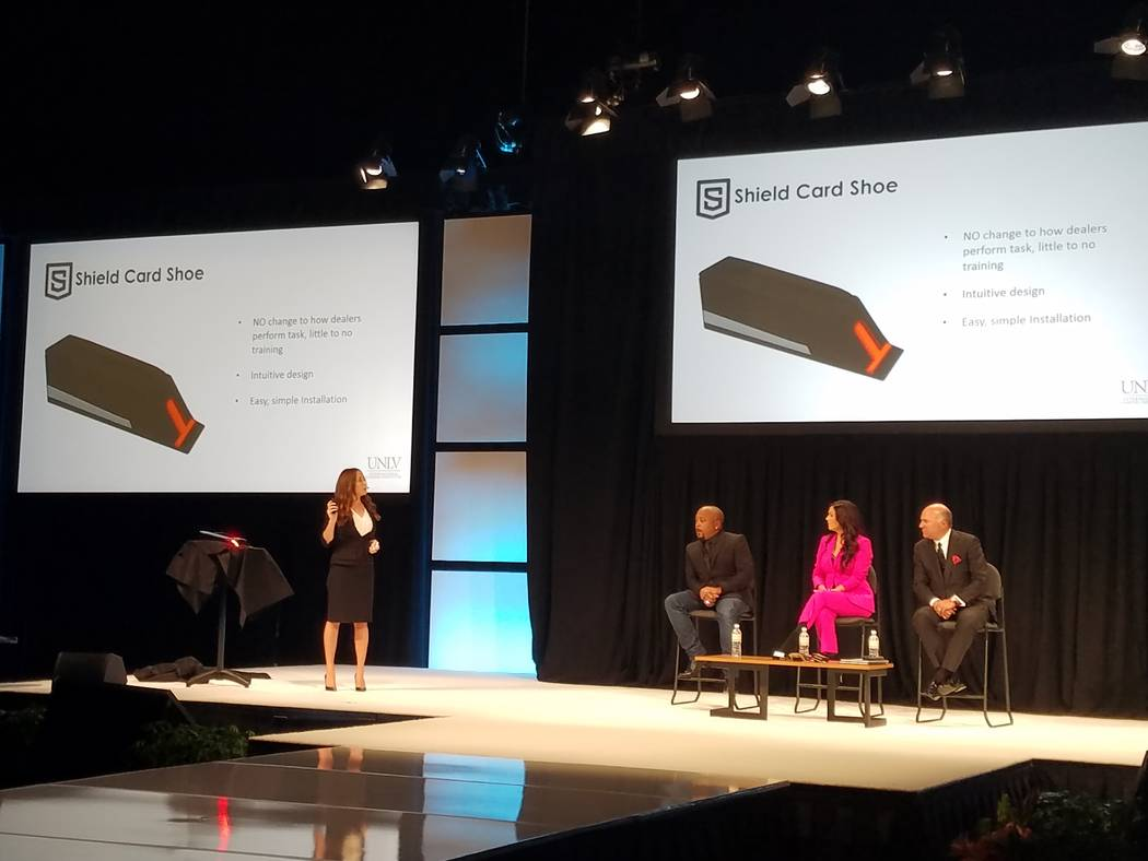 "Brittney Martino, UNLV's technology liaison for the Office of Economic Development, explains the Shield Card Shoe at the ""Innovation Incubator"" presentation at the Global Gaming Expo to judges D ..."