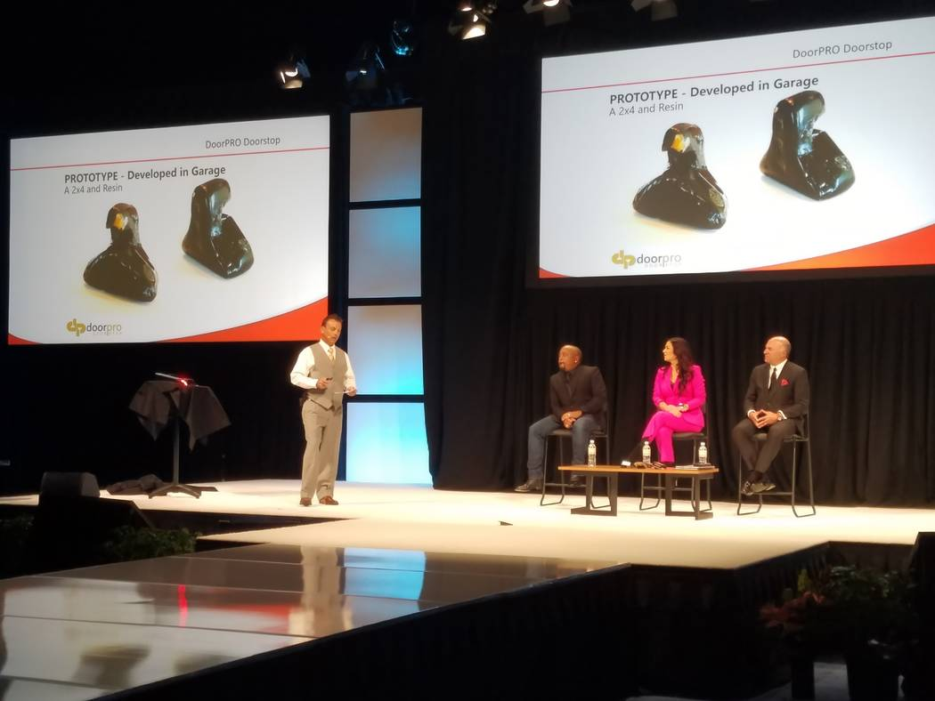 "Former bellman and UNLV graduate Bill Hengler, founder and CEO of DoorPro Doorstop, explains his winning entry, the DoorPro, at the ""Innovation Incubator"" presentation at the Global Gaming Expo to ..."