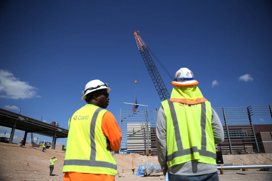 Workers watch as a steel beam is moved into place during a topping off ceremony at the Las Vegas Ballpark construction site in Las Vegas, Thursday, Oct. 11, 2018. Erik Verduzco Las Vegas Review-Jo ...