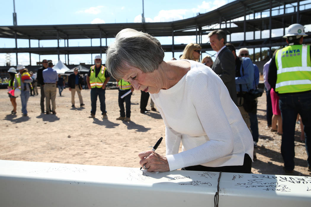 Clark County Commissioner Susan Brager signs a steel beam during a topping off ceremony at the Las Vegas Ballpark construction site in Las Vegas, Thursday, Oct. 11, 2018. Erik Verduzco Las Vegas R ...