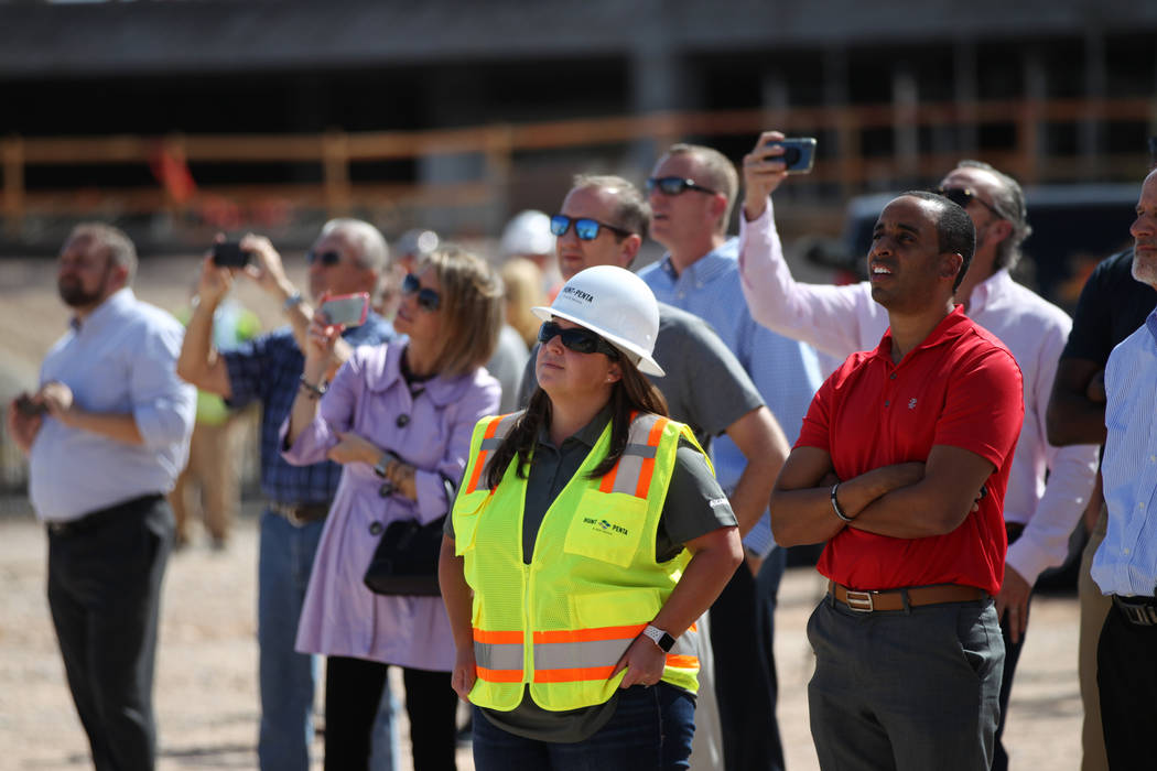 People watch as a steel beam is moved into place during a topping off ceremony at the Las Vegas Ballpark construction site in Las Vegas, Thursday, Oct. 11, 2018. Erik Verduzco Las Vegas Review-Jou ...