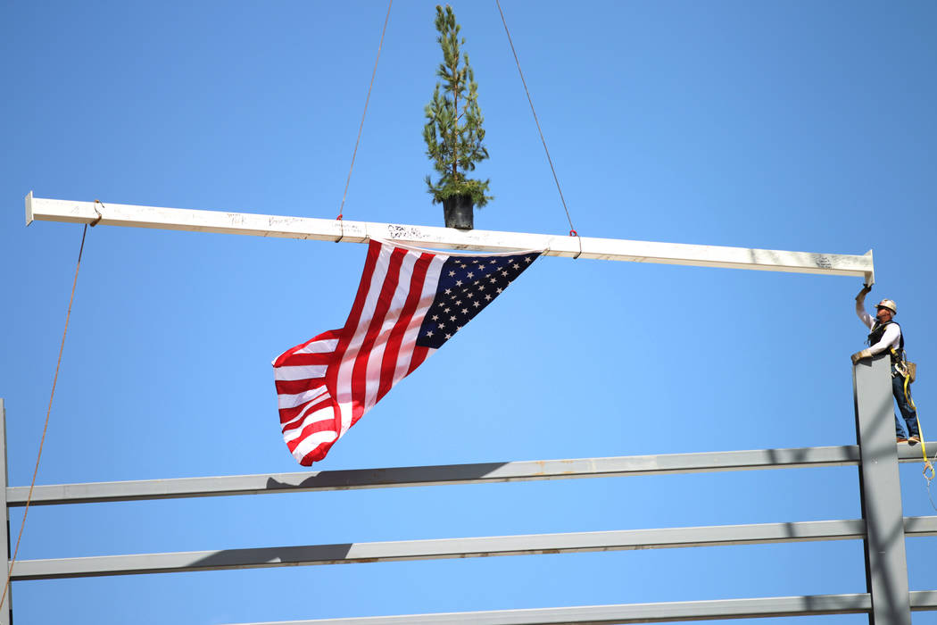 A steel beam is moved into place during a topping off ceremony at the Las Vegas Ballpark construction site in Las Vegas, Thursday, Oct. 11, 2018. Erik Verduzco Las Vegas Review-Journal @Erik_Verduzco