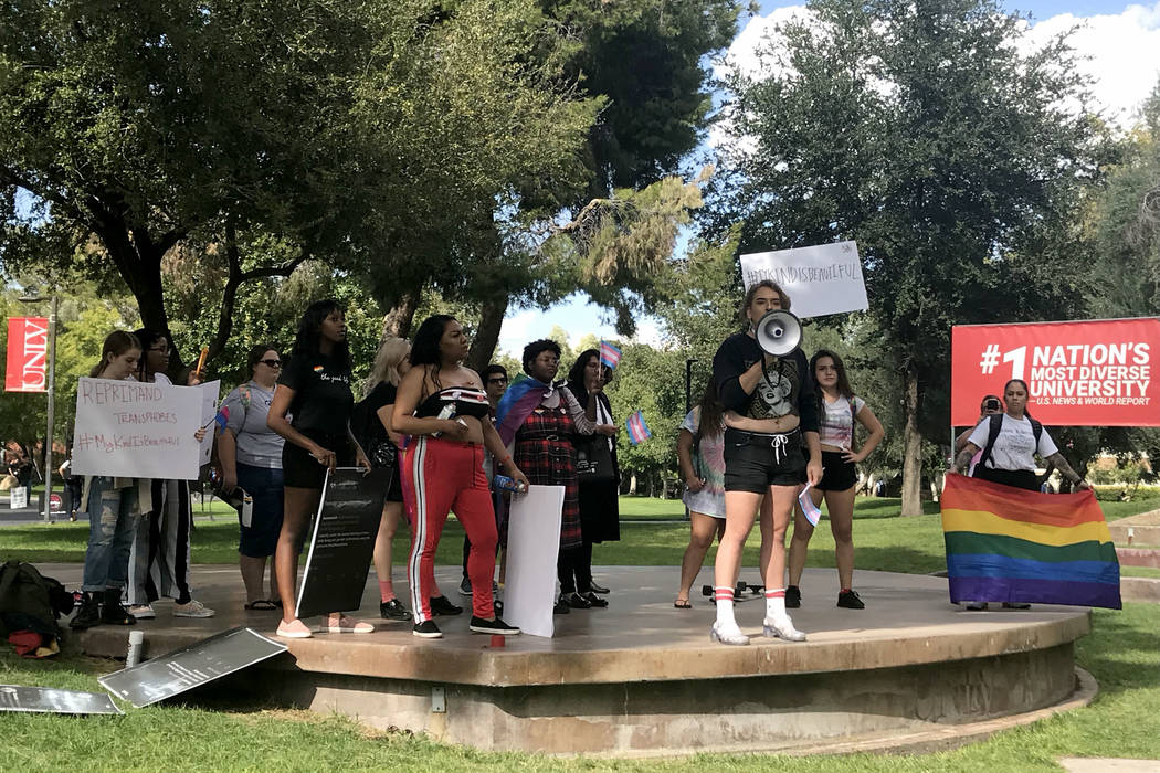 A group of about 20 students held a protest on UNLV campus on Thursday, Oct. 11, 2018, in support of UNLV student Alexander Kostan, center, who claims he was kicked out of a Kappa Sigma fraternit ...