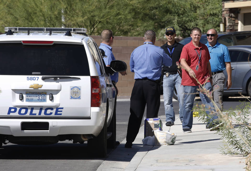 Henderson police investigate an officer-involved shooting in the 1500 block of Point Vista Avenue, near Patrick Lane and Whitney Ranch Drive, on Thursday, Sept. 13, 2018, in Henderson. (Bizuayehu ...