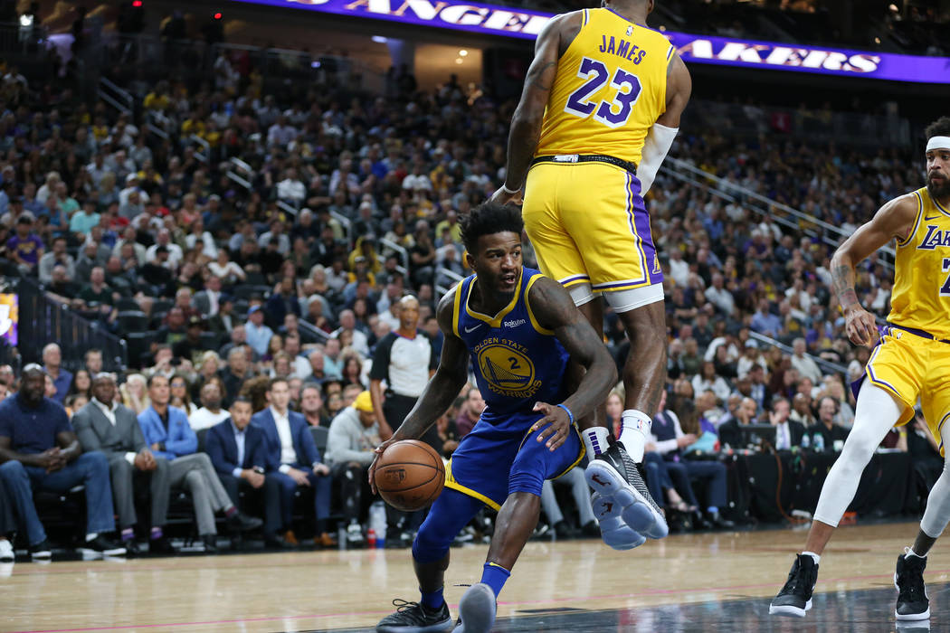 Golden State Warriors forward Jordan Bell (2) looks for an open shot under pressure from Los Angeles Lakers forward LeBron James (23) in the NBA game at T-Mobile Arena in Las Vegas, Wednesday, Oct ...