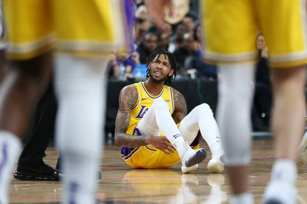 Los Angeles Lakers forward Brandon Ingram (14) reacts after getting called for a foul against Golden State Warriors guard Stephen Curry (30), not pictured, in the NBA game at T-Mobile Arena in Las ...