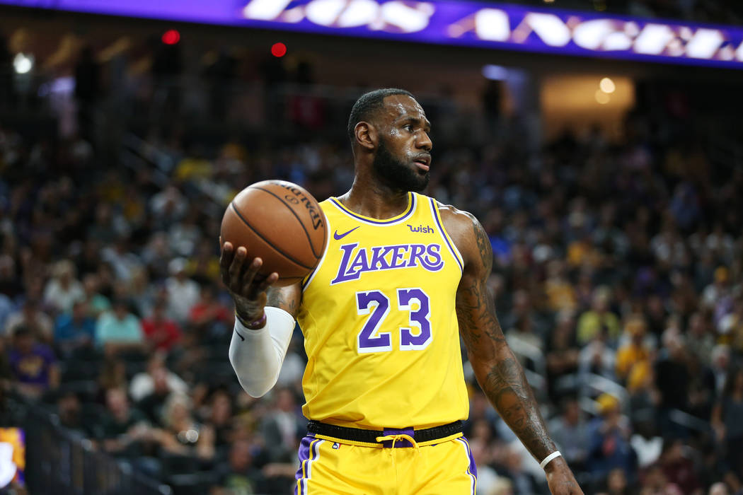 Los Angeles Lakers forward LeBron James (23) looks to inbound a pass during a preseason game against the Golden State Warriors at T-Mobile Arena in Las Vegas, Wednesday, Oct. 10, 2018. Erik Verduz ...
