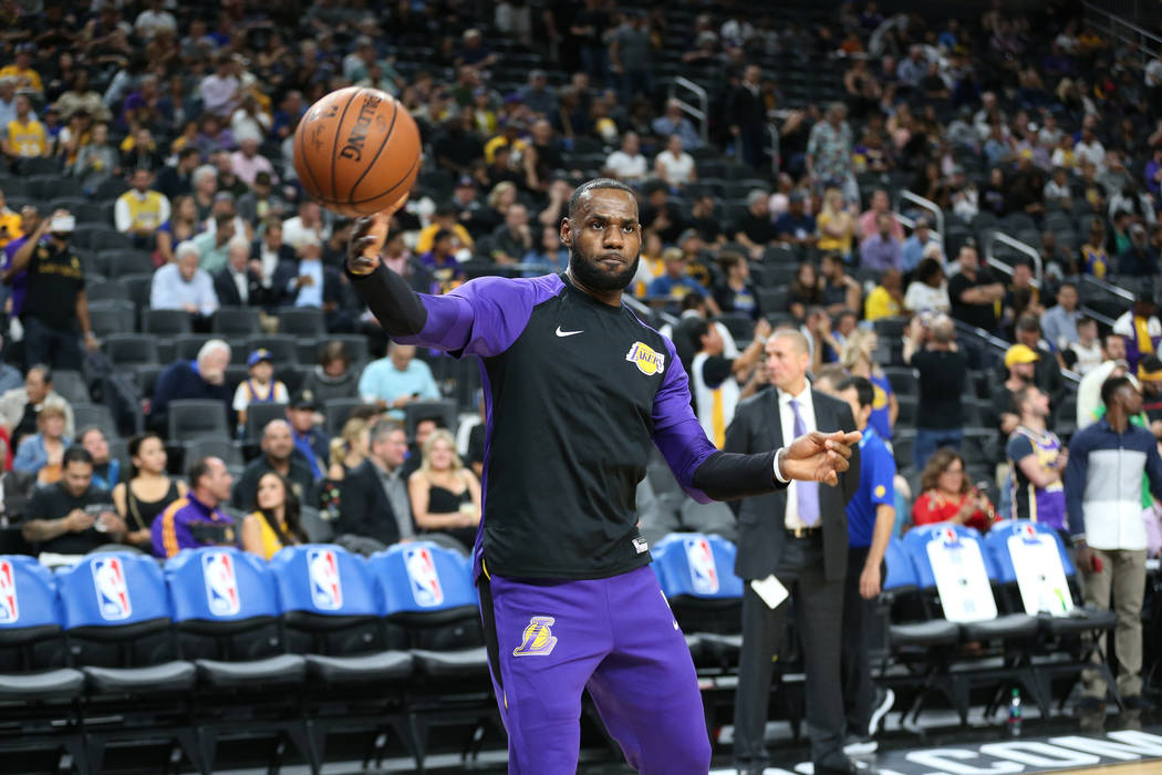 Los Angeles Lakers forward LeBron James (23) during warmups before a preseason game against the Golden State Warriors at T-Mobile Arena in Las Vegas, Wednesday, Oct. 10, 2018. Erik Verduzco Las Ve ...