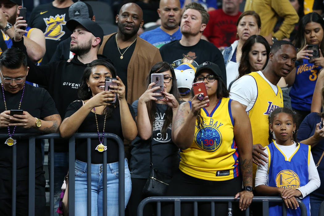 Fans get ready for the Golden State Warriors preseason game against the Los Angeles Lakers at T-Mobile Arena in Las Vegas, Wednesday, Oct. 10, 2018. Erik Verduzco Las Vegas Review-Journal @Erik_Ve ...