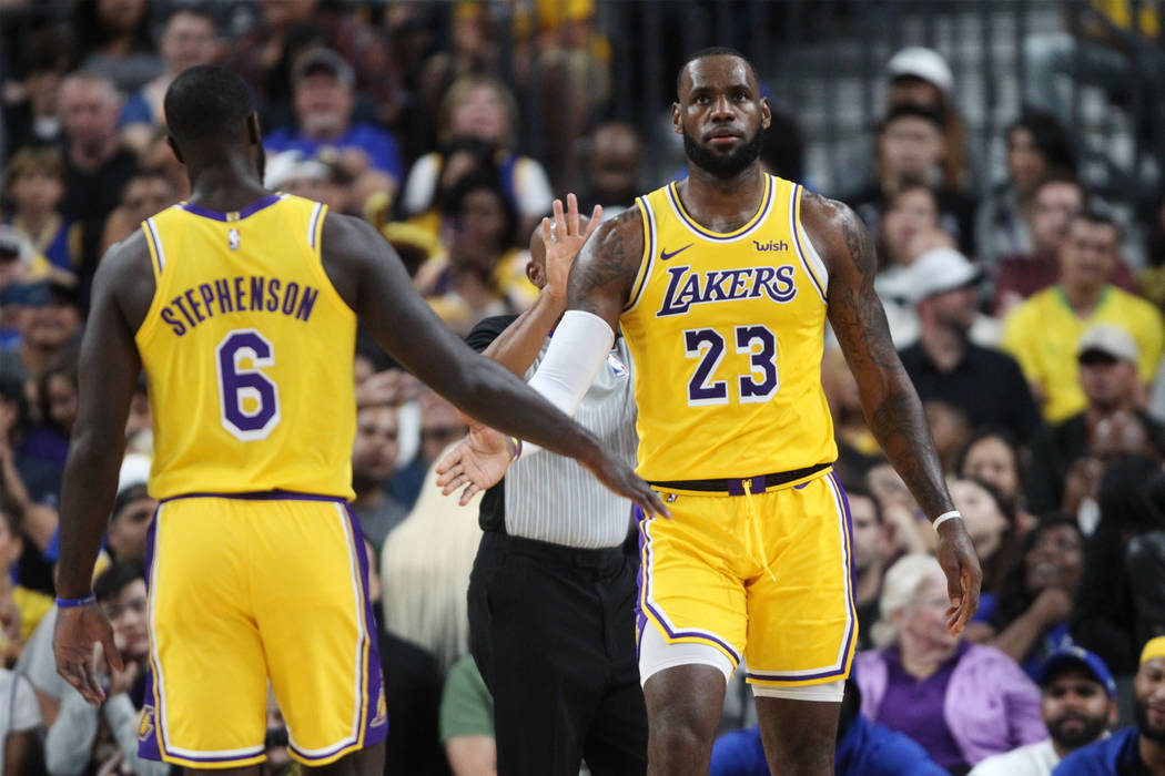 Los Angeles Lakers forward LeBron James (23) and guard Lance Stephenson (6) during their preseason game against the Golden State Warriors at T-Mobile Arena in Las Vegas, Wednesday, Oct. 10, 2018. ...