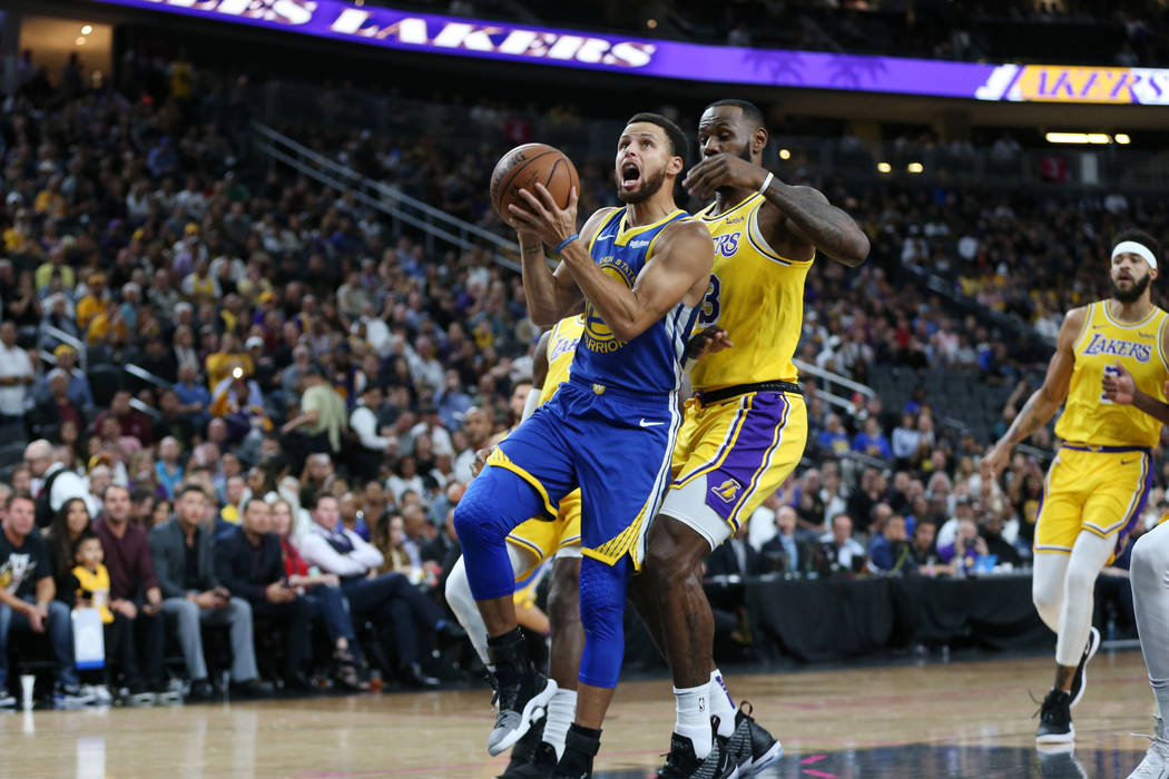 6a8eed096fe ... ESPN s most-watched preseason game ever. Golden State Warriors guard  Stephen Curry (30) takes a shot under pressure from Los