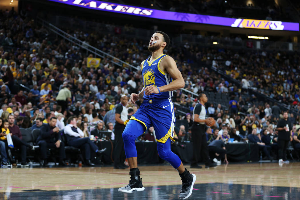 Golden State Warriors guard Stephen Curry (30) warms up before an NBA preseason game against the Los Angeles Lakers at T-Mobile Arena in Las Vegas, Wednesday, Oct. 10, 2018. Erik Verduzco Las Vega ...
