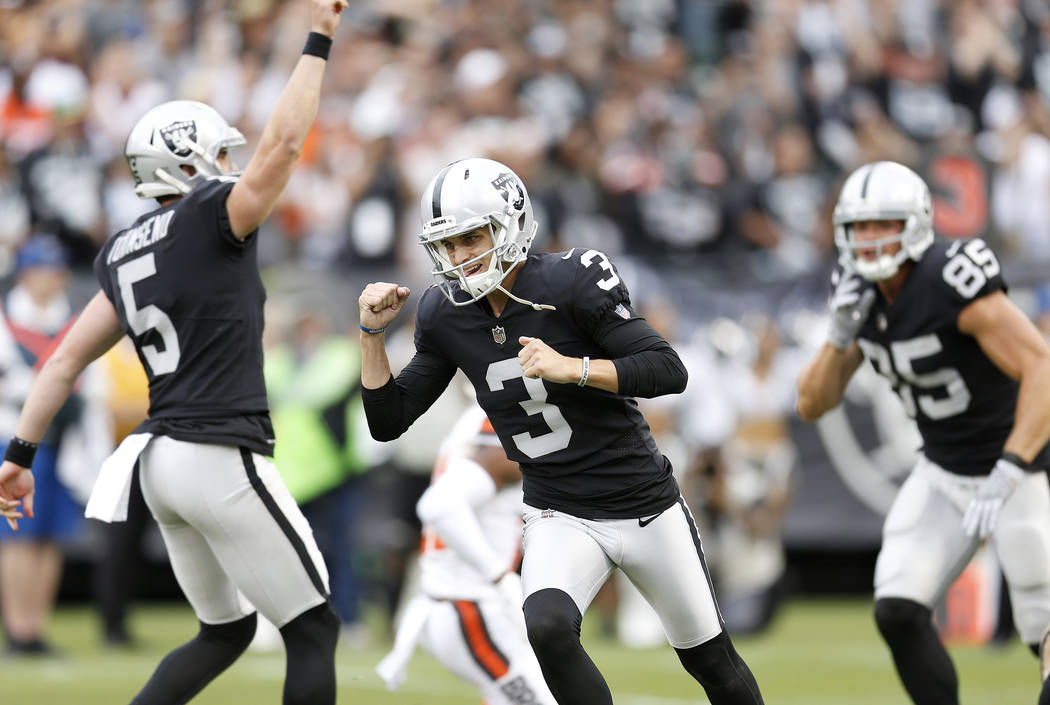 Oakland Raiders kicker Matt McCrane (3) celebrates after kicking the winning field goal against the Cleveland Browns during overtime of an NFL football game in Oakland, Calif., Sunday, Sept. 30, 2 ...