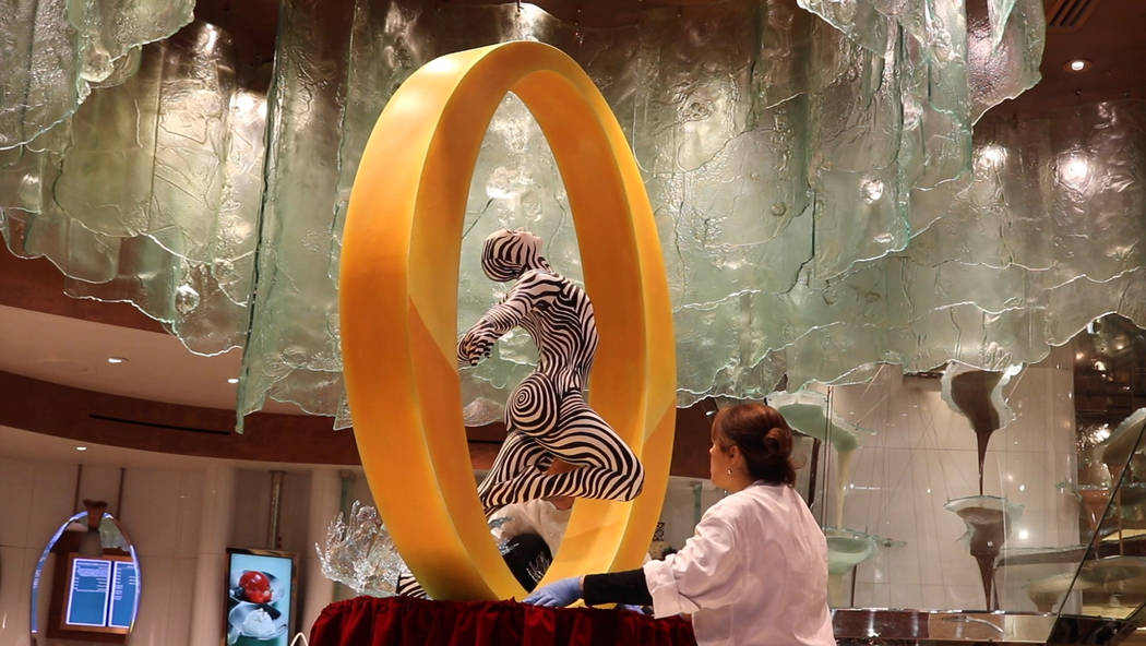 """Bellagio Patisserie assistant executive pastry chefs Yamilet Hillers and Jerome Jacob worked for four weeks to complete the chocolate """"O"""" sculpture. (Janna Karel Las Vegas Review-Journal)"""