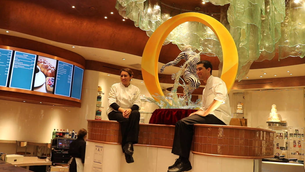 "Bellagio Patisserie assistant executive pastry chefs Yamilet Hillers and Jerome Jacob worked for four weeks to complete the chocolate ""O"" sculpture. (Janna Karel Las Vegas Review-Journal)"
