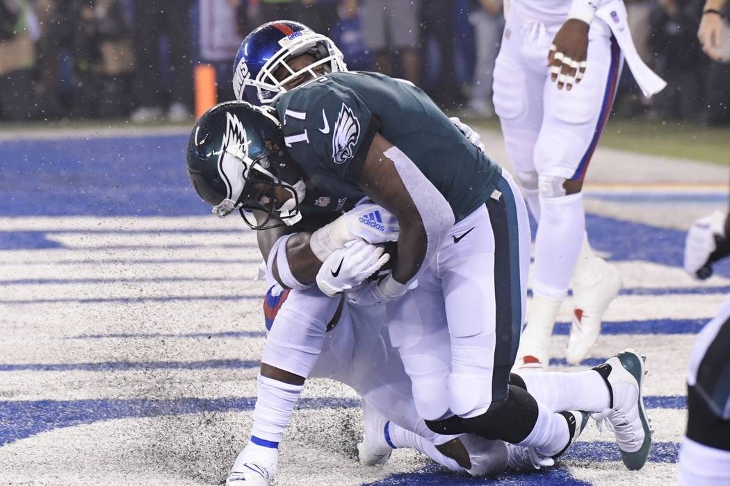 Philadelphia Eagles wide receiver Alshon Jeffery (17) catches a pass for a touchdown during the first half of the team's NFL football game against the New York Giants on Thursday, Oct. 11, 2018, i ...