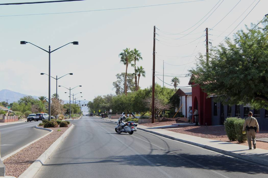 Las Vegas police investigate after a woman was struck and killed by a hit-and-run driver, Thursday, Oct. 11, on East St. Louis Street near 6th Street. (Max Michor/Las Vegas Review-Journal)