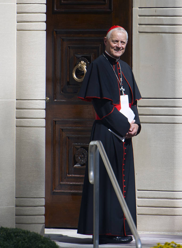 Cardinal Donald Wuerl, archbishop of Washington, stands in the doorway of the Apostolic Nunciature, the Vatican's diplomatic mission in Washington, D.C., Sept. 23, 2015. On Friday, Oct. 12, 2018, ...