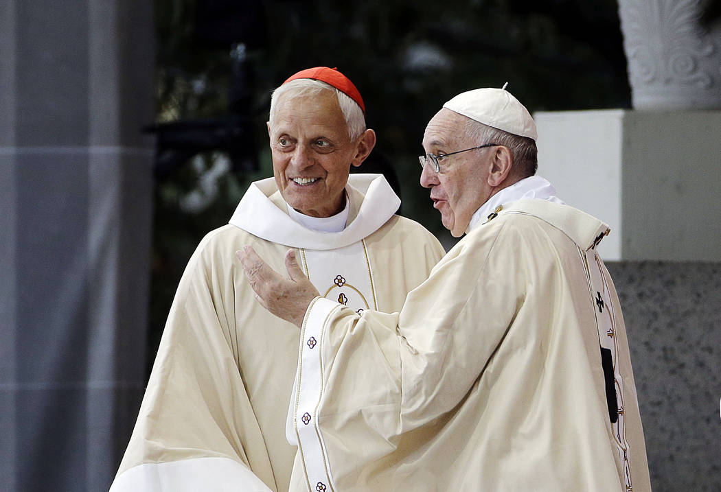 Cardinal Donald Wuerl, archbishop of Washington, left, talking with Pope Francis after a Mass in the Basilica of the National Shrine of the Immaculate Conception in Washington, D.C., Sept. 23, 20 ...