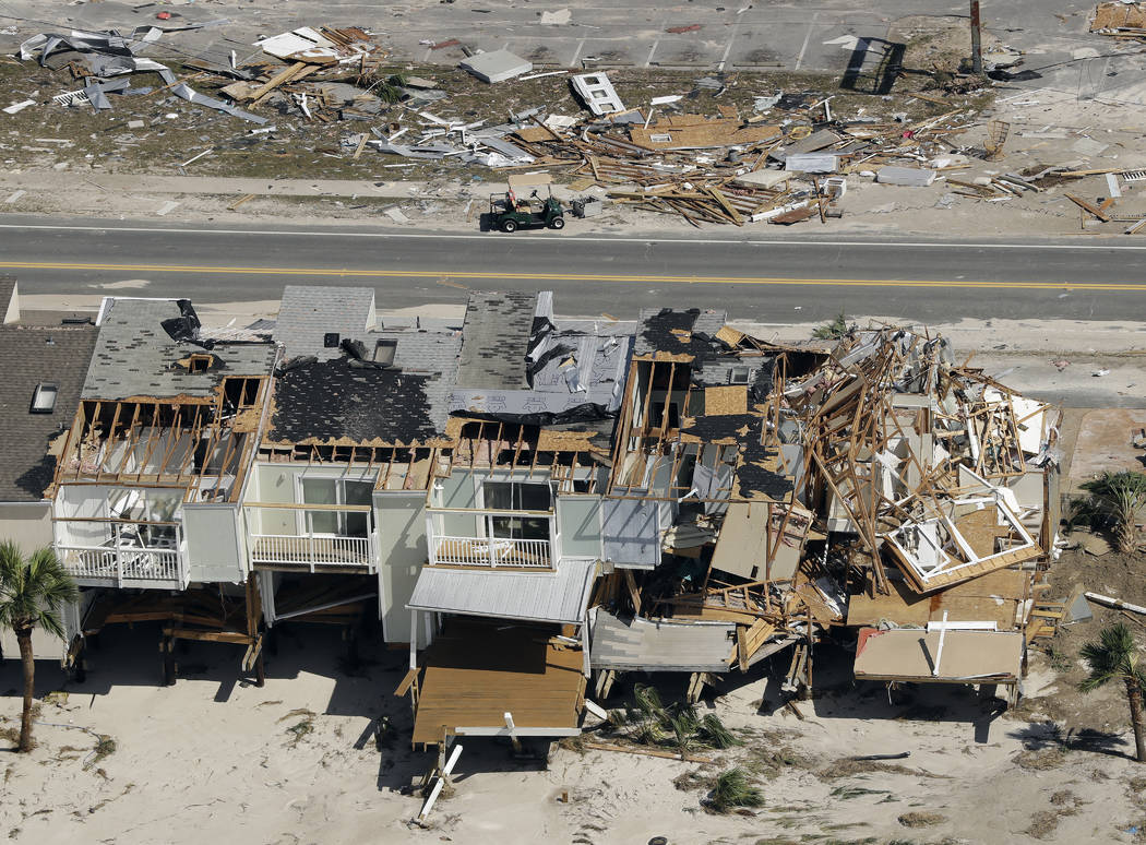 Homes destroyed by Hurricane Michael are shown in this aerial photo Thursday, Oct. 11, 2018, in Mexico Beach, Fla. The devastation inflicted by Hurricane Michael came into focus Thursday with rows ...