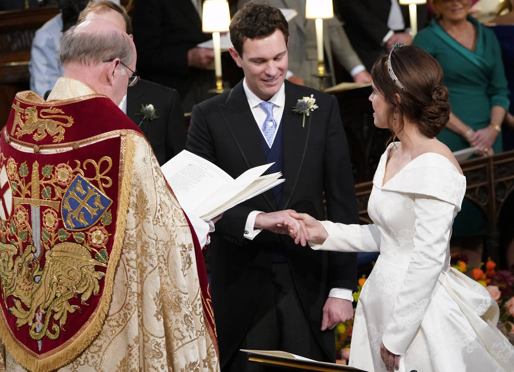 Britain's Princess Eugenie and Jack Brooksbank during their wedding ceremony in St George's Chapel, Windsor Castle, near London, England, Friday Oct. 12, 2018. (Danny Lawson/Pool via AP)