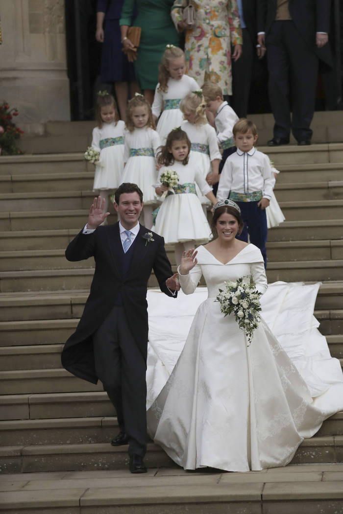 Princess Eugenie of York and Jack Brooksbank after their wedding ceremony at St George's Chapel, Windsor Castle, near London, England, Friday Oct. 12, 2018. (Andrew Matthews, Pool via AP)