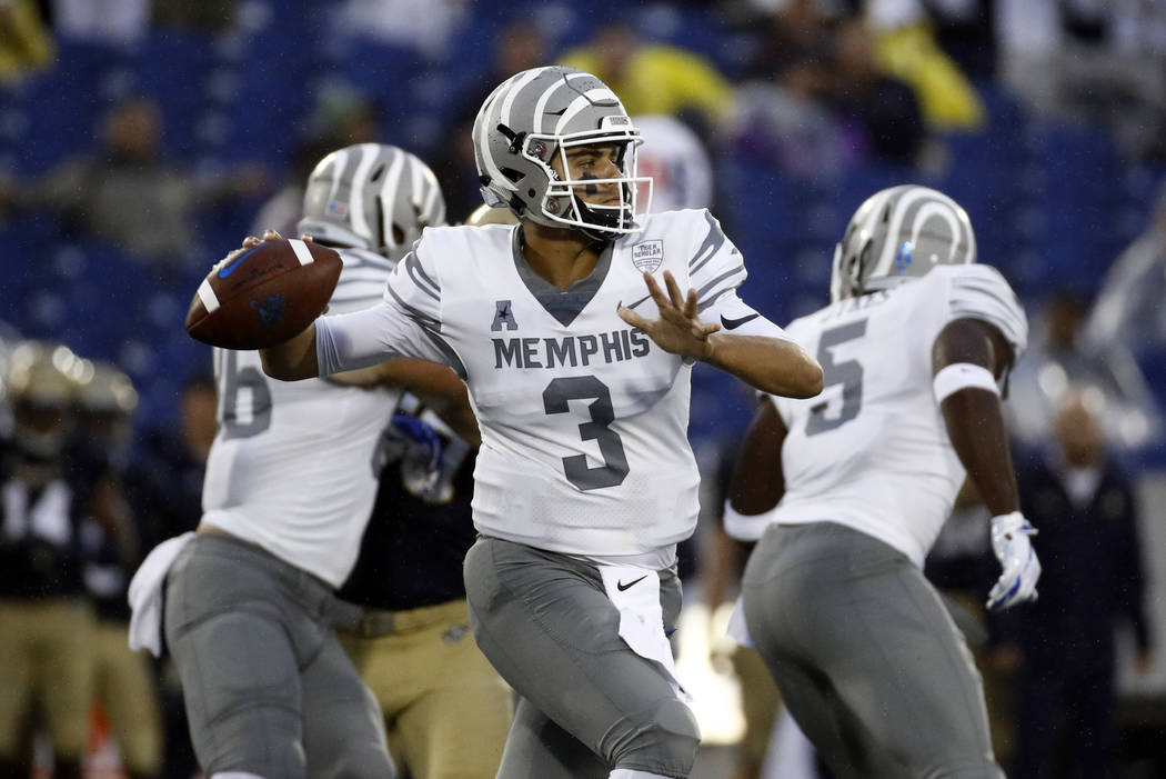 Memphis quarterback Brady White throws to a receiver in the second half of an NCAA college football game against Navy, Saturday, Sept. 8, 2018, in Annapolis, Md. (AP Photo/Patrick Semansky)