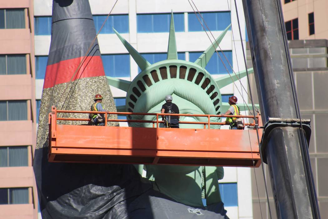 Workers at New York-New York finish putting a Golden Knights sweater on The Statue of Liberty. (Max Michor/Las Vegas Review-Journal)