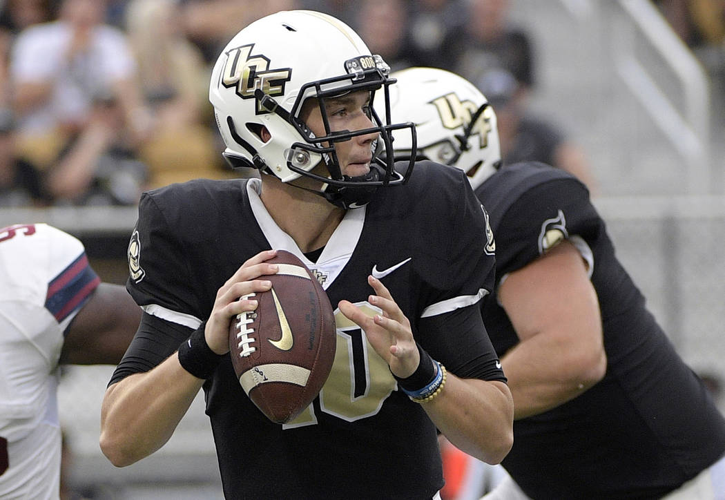 FILE - In this Sept. 8, 2018, file photo, Central Florida quarterback McKenzie Milton (10) throws a pass during the first half of an NCAA college football game against South Carolina State in Orla ...