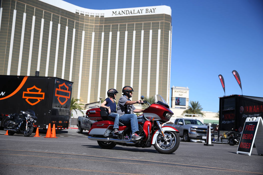 People ride a motorcycle off the demo lot during the American Motorcycle International Expo at the Mandalay Bay Convention Center in Las Vegas, Friday, Oct. 12, 2018. Erik Verduzco Las Vegas Revie ...