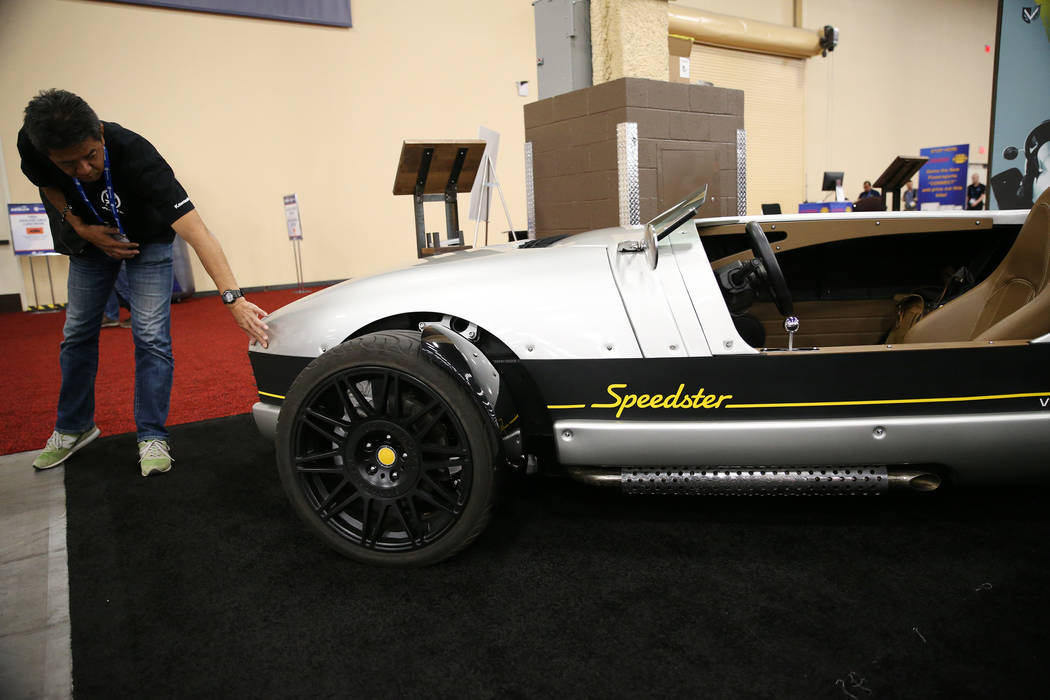 Takashi Yamada of Japan checks out a Vanderhall Speedster during the American Motorcycle International Expo at the Mandalay Bay Convention Center in Las Vegas, Friday, Oct. 12, 2018. Erik Verduzco ...