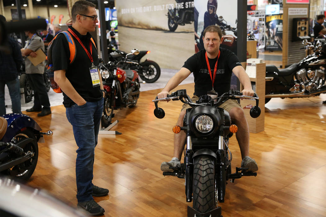 Ben George, left, and Andy Cleaver check out an Indian motorcycle on display during the American Motorcycle International Expo at the Mandalay Bay Convention Center in Las Vegas, Friday, Oct. 12, ...