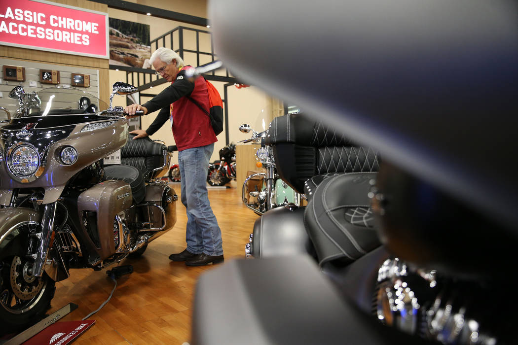 David Jones of Houston, Texas, looks at a Indian motorcycle on display during the American Motorcycle International Expo at the Mandalay Bay Convention Center in Las Vegas, Friday, Oct. 12, 2018. ...