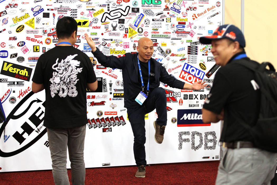 Rurong Chen of China is photographed at the entrance to the American Motorcycle International Expo at the Mandalay Bay Convention Center in Las Vegas, Friday, Oct. 12, 2018. Erik Verduzco Las Vega ...
