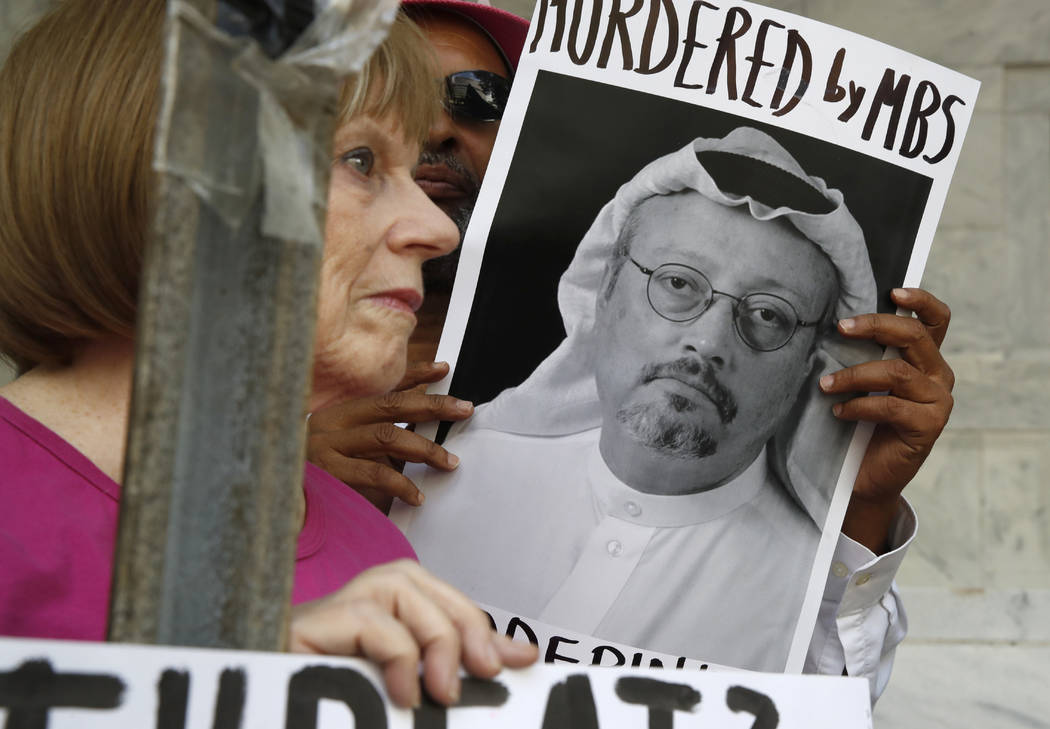 People hold signs during a protest at the Embassy of Saudi Arabia about the disappearance of Saudi journalist Jamal Khashoggi, Wednesday, Oct. 10, 2018, in Washington. (Jacquelyn Martin/AP)