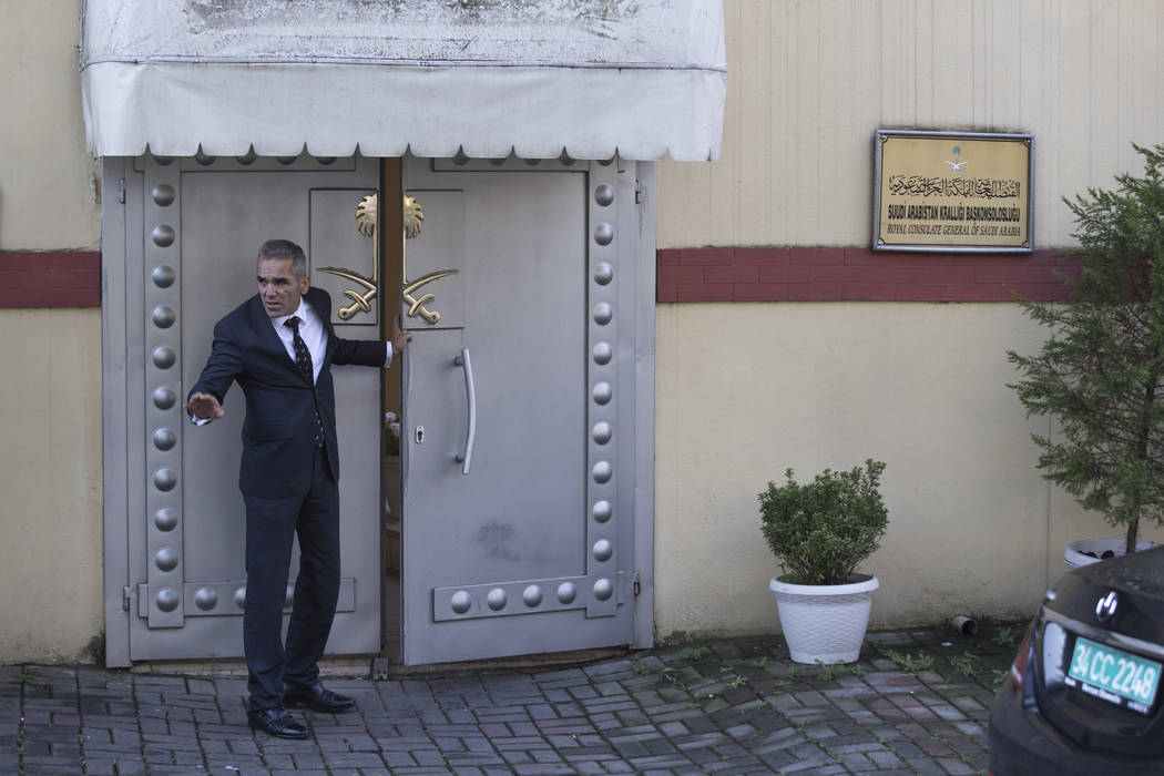 """A security guard speaks with colleagues at the entrance of Saudi Arabia's consulate in Istanbul, Friday, Oct. 12, 2018. A senior Turkish official says Turkey and Saudi Arabia will form a """"joint wo ..."""