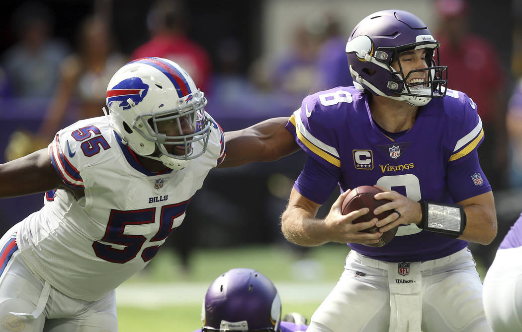 Buffalo Bills defensive end Jerry Hughes (55) pressures Minnesota Vikings quarterback Kirk Cousins (8) during the first half of an NFL football game, Sunday, Sept. 23, 2018, in Minneapolis. (AP Ph ...