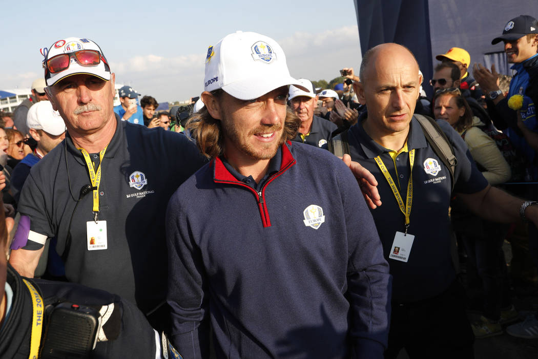 Europe's Tommy Fleetwood leaves the course after winning his foursome match on the opening day of the 42nd Ryder Cup at Le Golf National in Saint-Quentin-en-Yvelines, outside Paris, France, Friday ...