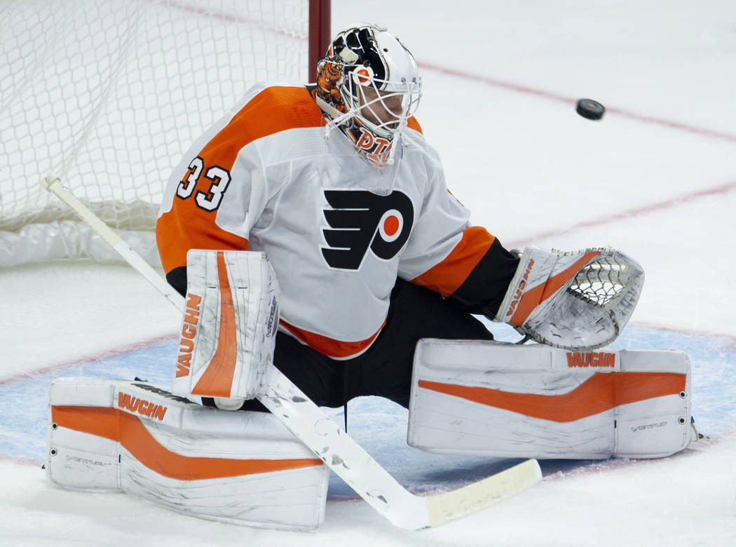 Philadelphia Flyers goaltender Calvin Pickard makes a save against the Ottawa Senators during the third period of an NHL hockey game Wednesday, Oct. 10, 2018, in Ottawa, Ontario. (Adrian Wyld/The ...