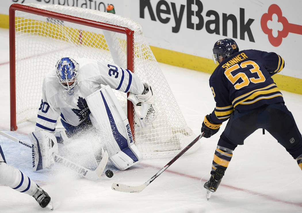 Toronto Maple Leafs goalie Calvin Pickard, left, stops a shot by Buffalo Sabres center Jeff Skinner during the third period of an NHL preseason hockey game in Buffalo, N.Y., Saturday, Sept. 22, 20 ...