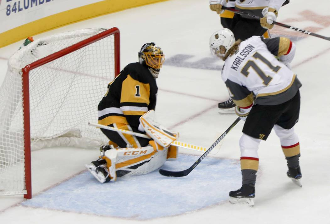 Vegas Golden Knights' William Karlsson (71) looks for a rebound after Tomas Nosek (92) scored on Pittsburgh Penguins goaltender Casey DeSmith (1) during the first period of an NHL hockey game, Thu ...