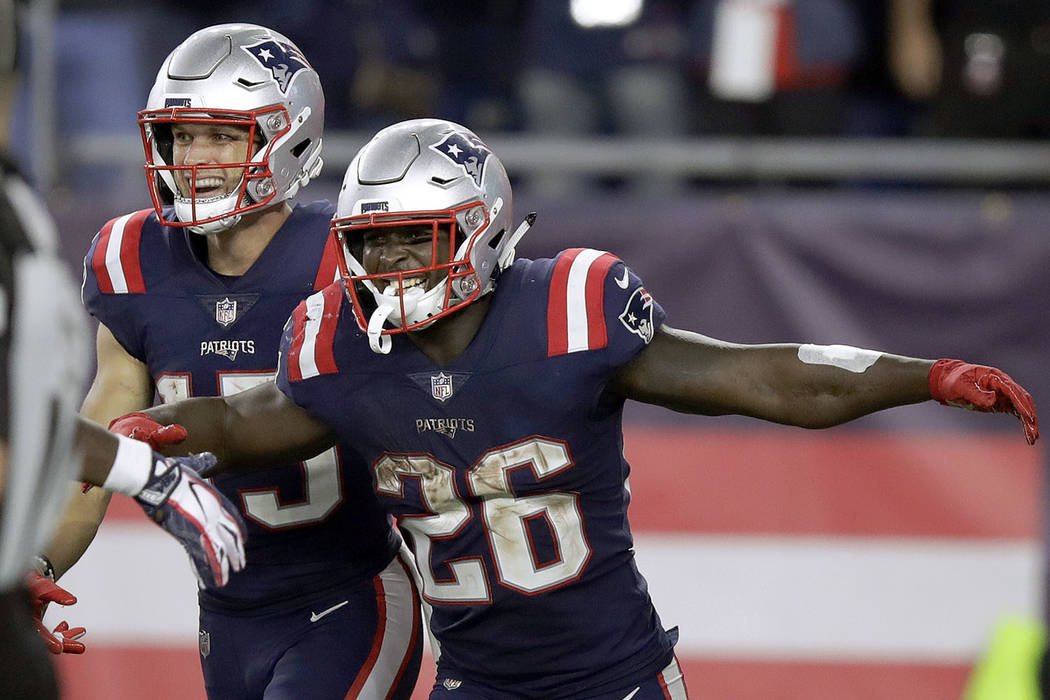 New England Patriots running back Sony Michel (26) celebrates his touchdown run during the second half of an NFL football game against the Indianapolis Colts, Thursday, Oct. 4, 2018, in Foxborough ...