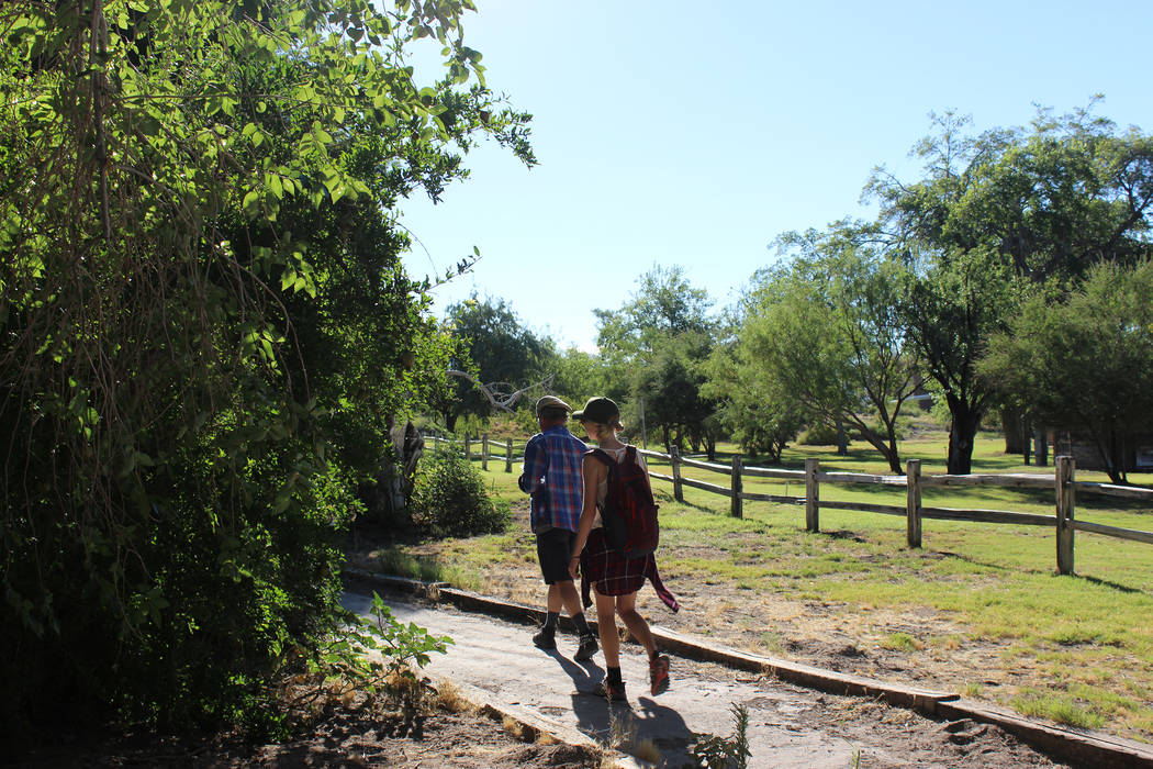 Visitors walk by the fruit orchard at Corn Creek at Desert National Wildlife Refuge. (Deborah Wall/Las Vegas Review-Journal)
