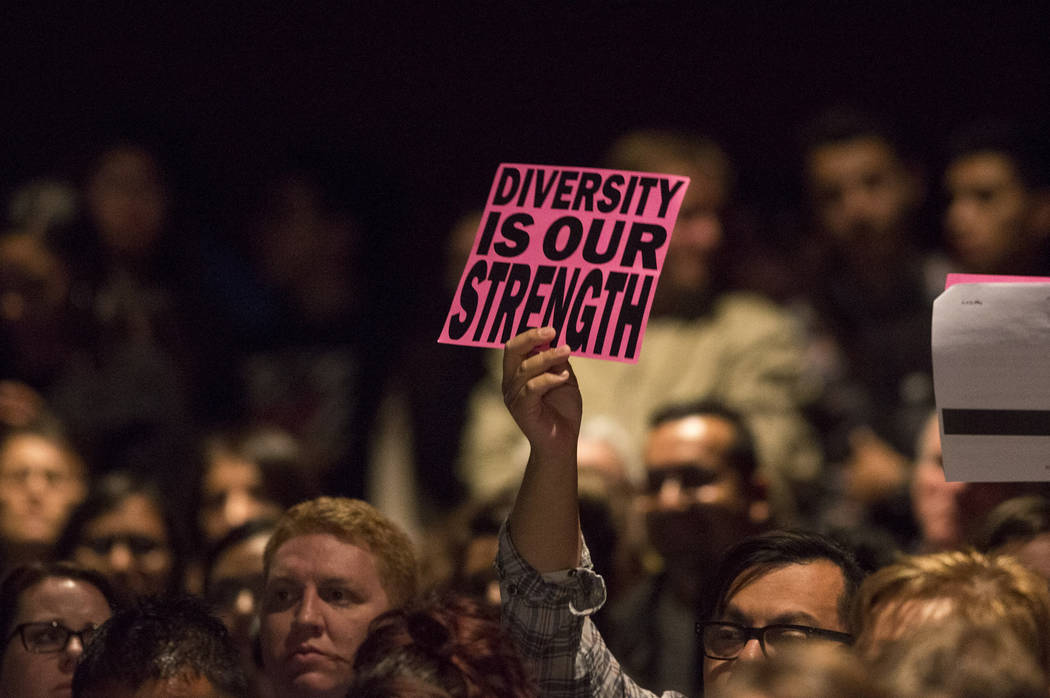 A gender-diverse proponent holds a sign during a special Clark County input meeting on a potential district gender-diverse policy at Valley High School in Las Vegas, Monday, Jan. 29, 2018. Richard ...